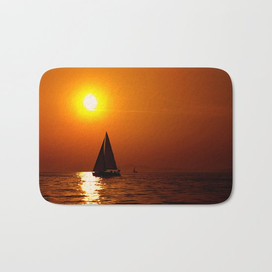 A sailboat at sunset Bath Mat