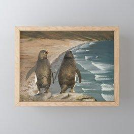 Close up of two rockhopper penguins on a beach Framed Mini Art Print