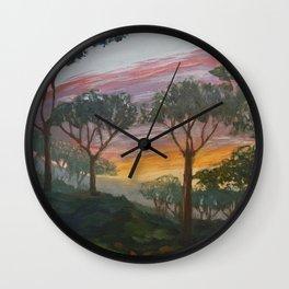 Sunset over pine hill Wall Clock