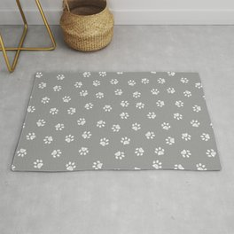 Doodle white paw print seamless fabric design repeated pattern with grey background Rug