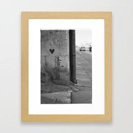 Reaching for love in Pisa Framed Art Print