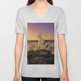 Magical sunset and waves breaking over rocky beach Unisex V-Neck