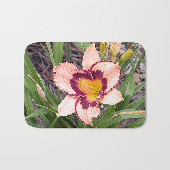 Pink daylily growing in Queensland Bath Mat
