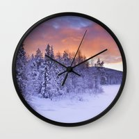 levi Wall Clocks featuring II - Sunrise over a river in winter near Levi, Finnish Lapland by Sara Winter