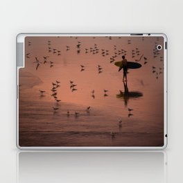 Lone surfer walks along beach at sunset Laptop & iPad Skin