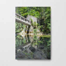 Pedestrian bridge crossing wild river with old mill building Metal Print