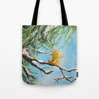 woodstock Tote Bags featuring Winter Woodstock by artmonkeyworld