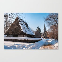 Picturesque street covered in snow at the Village Museum in Bucharest Canvas Print
