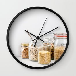 grains, legumes and nuts on concrete background Wall Clock