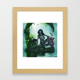 The dark fairy with cute little kitten Framed Art Print