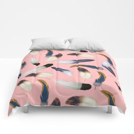 Pattern with feathers on a pink background Comforters