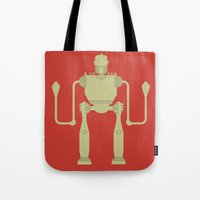 iron giant Tote Bags featuring The Iron Giant  by Stefanoreves