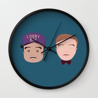 the grand budapest hotel Wall Clocks featuring Gustave & Zero - Grand Budapest Hotel by InQuadricromia