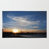 stockholm Area & Throw Rugs featuring Stockholm sunset by MrJane