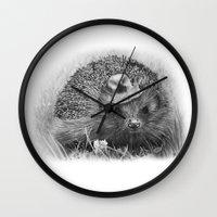 hedgehog Wall Clocks featuring Hedgehog by MARIA BOZINA - PRINT