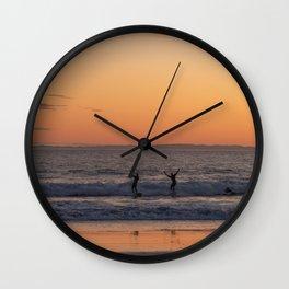 Happy Surfers at Sunset in Santa Barbara, California Wall Clock