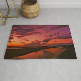 The Beach at sunset Rug