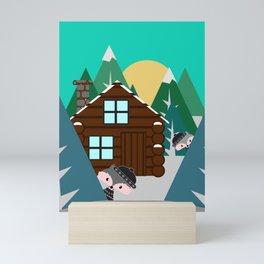 Winter cabin in the woods Mini Art Print