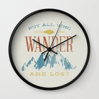 not all who wander are lost Wall Clocks featuring Not All who Wander are Lost by Zeke Tucker