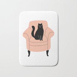 black cat on a chair Bath Mat
