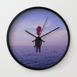 A Man In The Middle Wall Clock