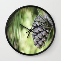 rileigh smirl Wall Clocks featuring Pinecone by Rileigh Smirl