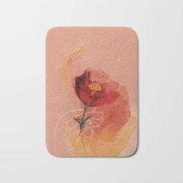 Hand Holding Flower Bath Mat