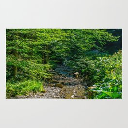 Small Creek in the Forest Rug