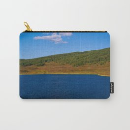Calm water pond with greenery on mountain in background Carry-All Pouch