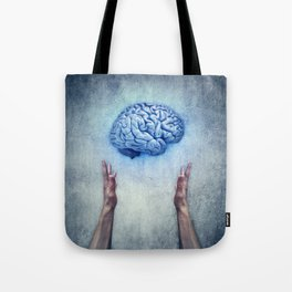 holding brain Tote Bag
