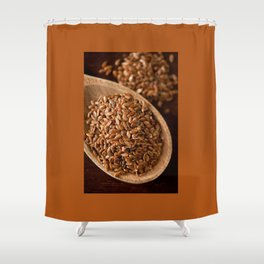 Brown flax seeds portion on wooden spoon Shower Curtain
