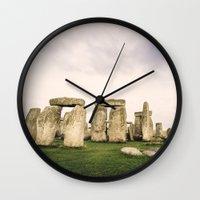 matty healy Wall Clocks featuring Stonehenge by Solar Designs