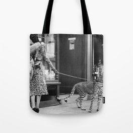 Woman with Cheetah, Phyllis Gordon, with her pet Kenyan cheetah, Paris, France black and white photo Tote Bag