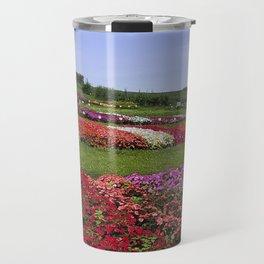 Floral patchwork under a blue sky Travel Mug