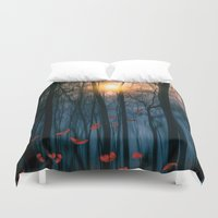 marianna Duvet Covers featuring Red feather dance  (colour option) by Viviana Gonzalez