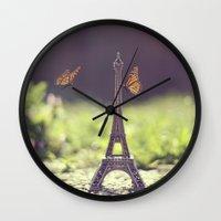 eiffel tower Wall Clocks featuring Eiffel Tower by Gabriela Da Costa