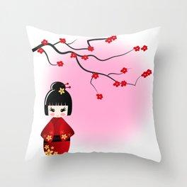 Japanese kokeshi doll at sakura blossoms Throw Pillow