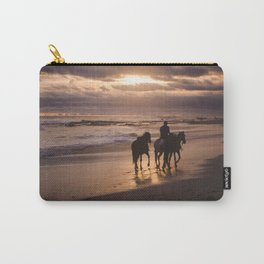 Silhouette of man riding his horses along the shore of a paradise beach in Costa Rica at sunset Carry-All Pouch