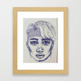 Boy in blue pen Framed Art Print