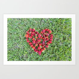 Heart made of strawberries with grass in the background Art Print