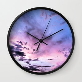 fly up to the blue pink sky Wall Clock