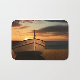 The boat in the sunset Bath Mat