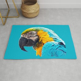 Macaw portrait on a turquoise background Rug