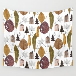 Pattern with autumn leaves and houses and spruces. Wall Tapestry