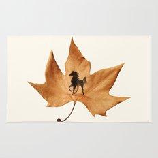 Horse on a dried leaf Rug