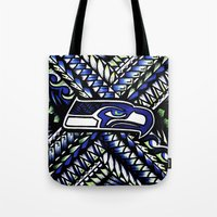 seahawks Tote Bags featuring Seahawks new tribal look by Lonica Photography & Poly Designs