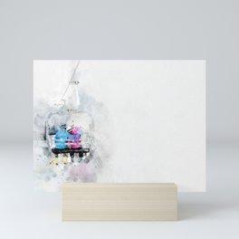 Lovers on a ski lift Mini Art Print