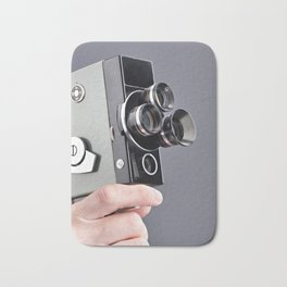 Retro hobbies movie camera in hands Bath Mat