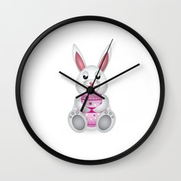 Easter bunny with pink egg Wall Clock