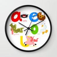 spanish Wall Clocks featuring Vowels (spanish) by Alapapaju